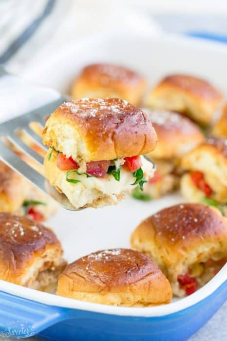 Italian Chicken Bruschetta Sliders are the perfect easy appetizers for feeding a crowd. Best of all, they come together in less than 30 minutes with tender chicken, juicy balsamic tomatoes, gooey Mozzarella and a melted buttery topping. So amazingly delicious for parties, barbecues, cookouts picnics, potlucks or any game day get-together or as an after-school snack.