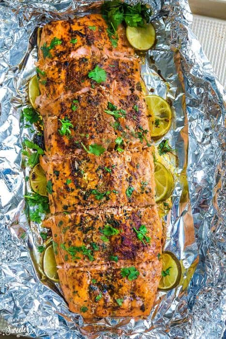 Chili Lime Salmon baked in foil on one sheet pan is fresh, flavorful and super delicious! Best of all, this recipe comes together in less than 30 minutes with tangy lime, chili powder and fresh parsley. The perfect weeknight meal!