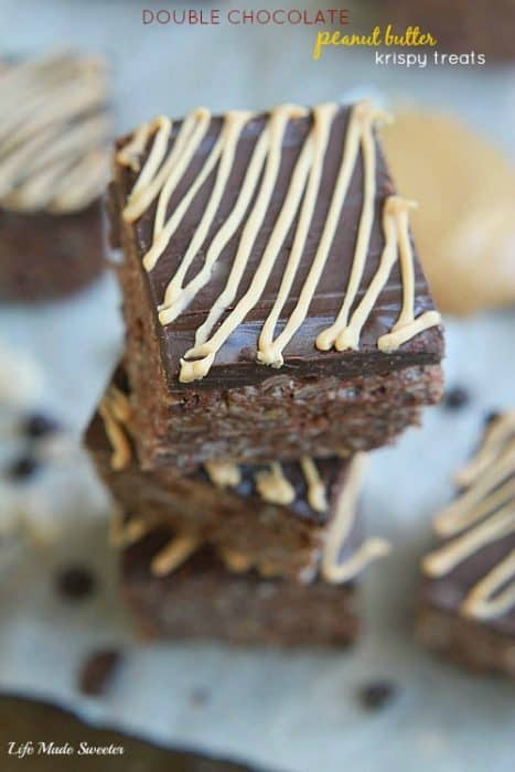 Double Chocolate Peanut Butter Krispy Treats from - Rich and delicious chocolate Rice Krispy Treats topped with a decadent chocolate and peanut butter ganache. @LifeMadeSweeter