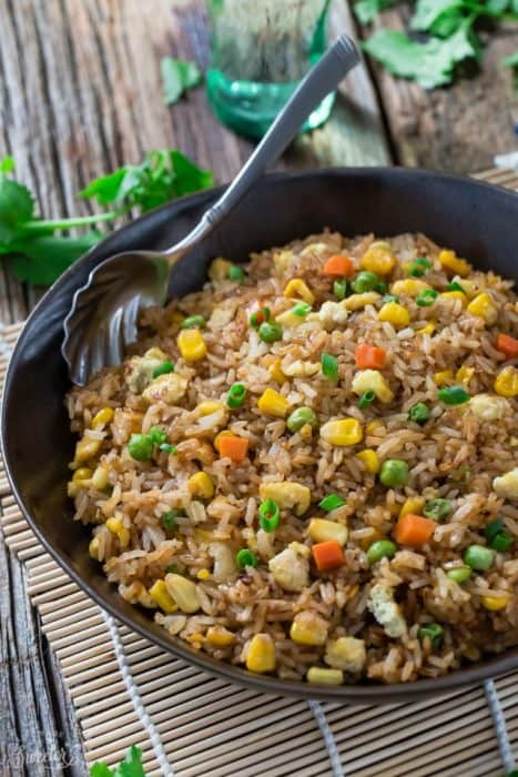 Chinese Fried Rice makes the perfect easy weeknight dish. With the most authentic flavors! My father was the head chef at a top Hong Kong Chinese restaurant and this was his specialty! So delicious and way better than any takeout!