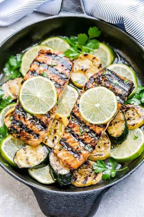 This Honey Lime Salmon is a light and tasty dish that is just perfect for summer and busy weeknights. Best of all, it can be made on the grill or in your oven. It's marinated with a delicious sweet and tangy honey and lime butter sauce and the salmon gets cooked to tender flaky perfection every time! Clean up is a breeze if you want to roast it in foil packs or cook it directly on the grill for those pretty grill marks!