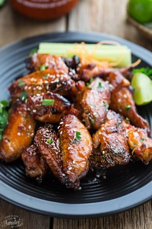 Honey Lime Sriracha Chicken Wings makes the perfect appetizers for game day. Best of all, they're so easy to make with a flavorful and delicious Asian inspired sticky sauce.