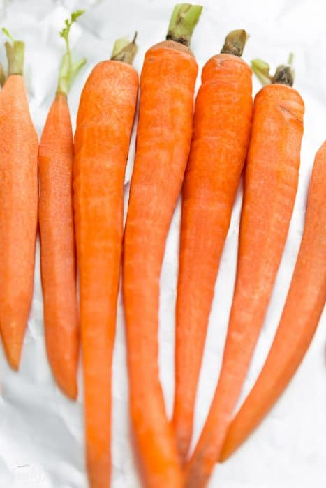 Honey Roasted Carrots is an easy side dish recipe that's perfect for potlucks, holidays and any busy weeknight. Best of all, you can easily customize it with rainbow carrots and your favorite seasonings.