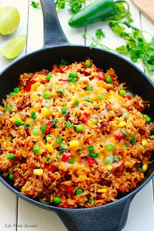 One Pan Mexican Rice Skillet makes the perfect easy 30 minute weeknight meal! Best of all, so simple to customize and everything cooks all in ONE pot - even the rice! Leftovers would be so delicious for school lunchboxes or work lunch bowls and you can even use this recipe for Sunday meal prep!