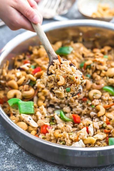 One Pot Cashew Chicken Rice is the perfect easy weeknight meal. Best of all, everything cooks up in just ONE pan {plus bonus Instant Pot pressure cooker instructions} and has all the flavors of your favorite takeout restaurant dish. A great Sunday meal prep recipe for your work or school lunchbox or lunch bowl and way better than takeout!