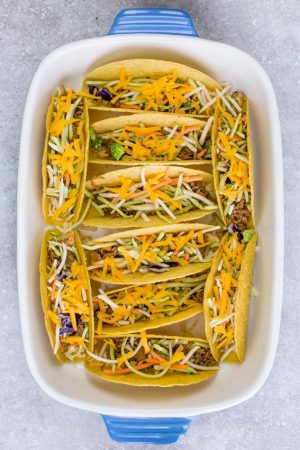 Baked Asian Sesame Chicken Tacos – a simple and delicious recipe perfect for busy weeknights and Cinco de Mayo. Best of all, a short recipe video. Layered with sweet and savory sesame chicken, rainbow vegetables, and a blend of 3 cheeses. Flavor packed and addicting!