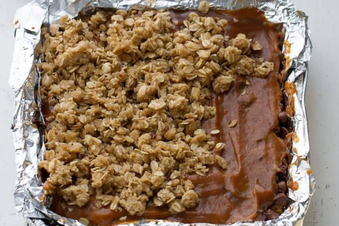 Pumpkin Carmelitas are the easy treat for fall. Best of all, they're soft, chewy and full of delicious layers of oatmeal, pumpkin, pumpkin spice, chocolate and gooey caramel. Great for bringing along to dessert bars or any potluck or parties.