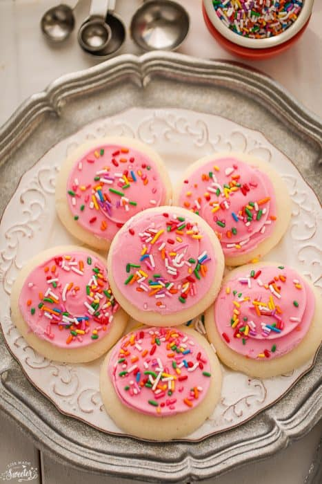 Soft Lofthouse Style Frosted Sugar Cookies are the perfect sweet treat with a tall glass of milk
