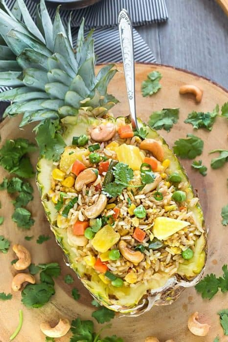 This Pineapple Fried Rice recipe is the perfect easy weeknight side dish to your meal. Best of all, it's easy to customize with any protein like chicken or shrimp and you can add your favorite Thai flavors.. Greta way to clean out your fridge with all those extra vegetables and leftovers also make a great meal to pack for work or school lunch bowls.