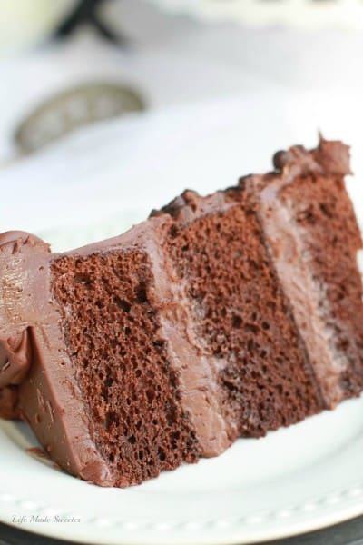 Ultimate Triple Chocolate Layer Cake - The best triple layer chocolate cake with the easiest milk chocolate frosting covered with mini chocolate chips.Ultimate Triple Chocolate Layer Cake - The best triple layer chocolate cake with the easiest milk chocolate frosting covered with mini chocolate chips.